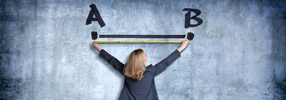 Woman measuring distance between letters A and B