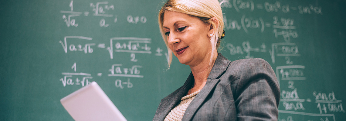Math professor in front of chalkboard